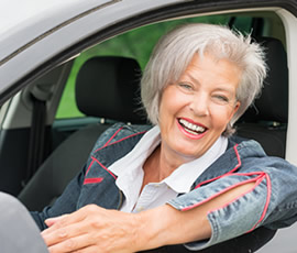 senior female in a car smiling