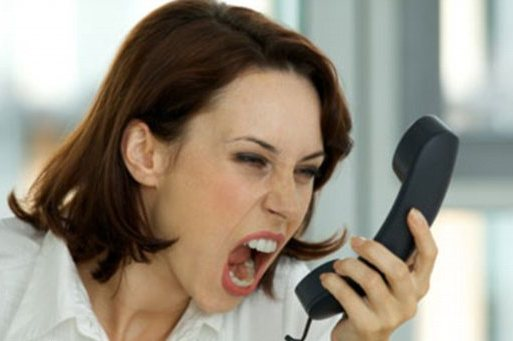 woman yelling into phone